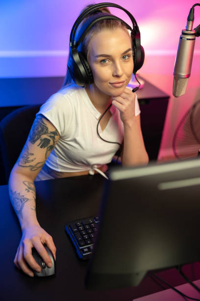 Professional esport gamer girl live streaming and plays online video game on PC stock photo