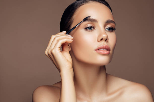 Professional eyebrow care stock photo