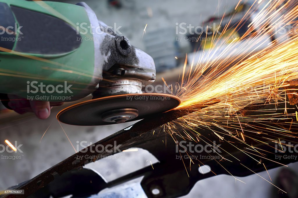 professional factory grinder cutting through metal stock photo