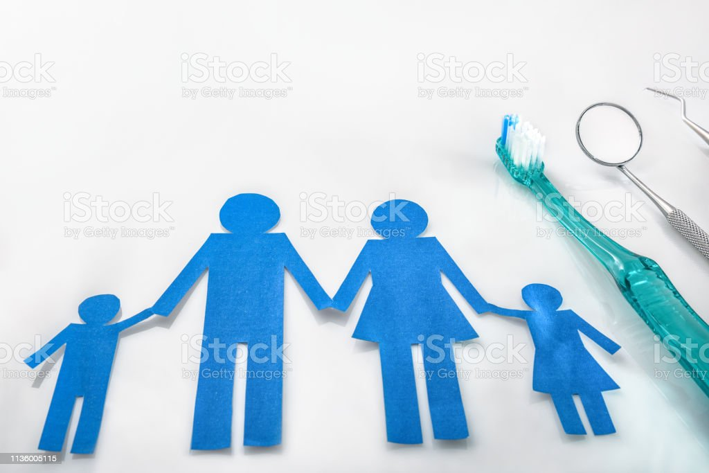 Professional family concept dentist with tools on white table stock photo