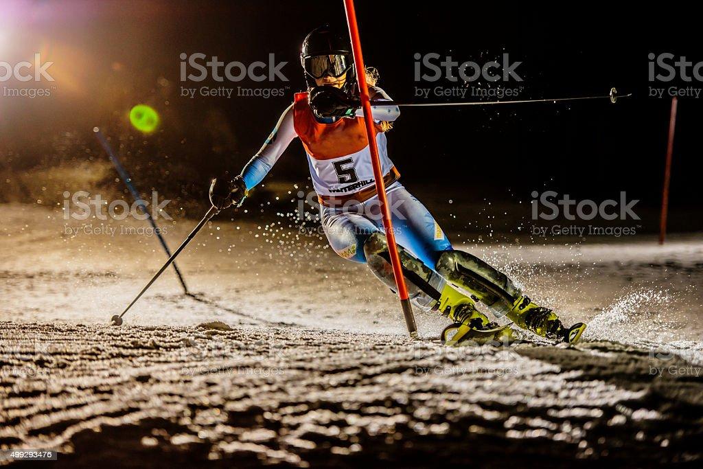 Professional female alpine skiier practicing in the night stock photo