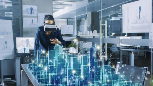 professional female architect wearing  augmented reality headset work with 3d city model. high tech office use virtual reality modeling software application. - hologram stock photos and pictures