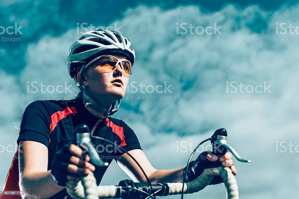 Professional female bike rider rides bicycle stock photo