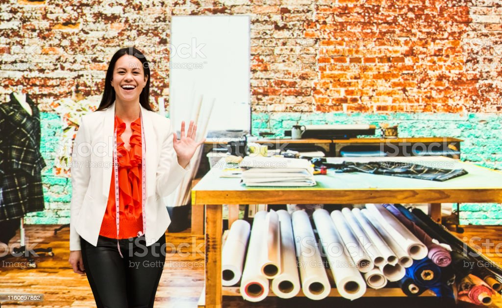 Professional Female Fashion Designer At Work And Waving Stock Photo Download Image Now Istock