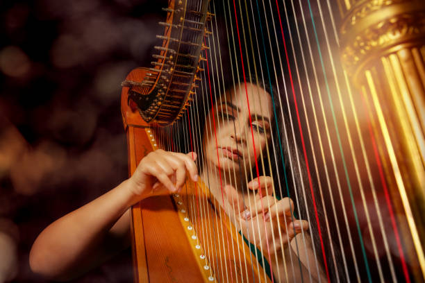 Professional female harpist during performance stock photo