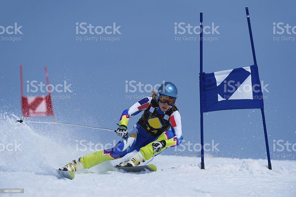 Professional Female Skier at Giant Slalom Ski Race stock photo