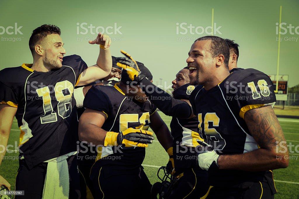 Professional Football Players Celebrate After Winning stock photo