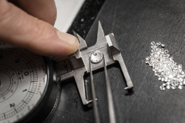 Professional gemstone settings jewellery craft laboratory: Choosing diamonds stock photo