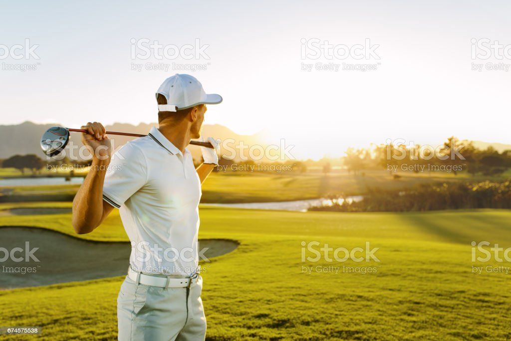 Professional golfer at golf course stock photo