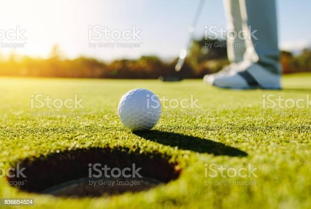 Photo of Professional golfer putting ball