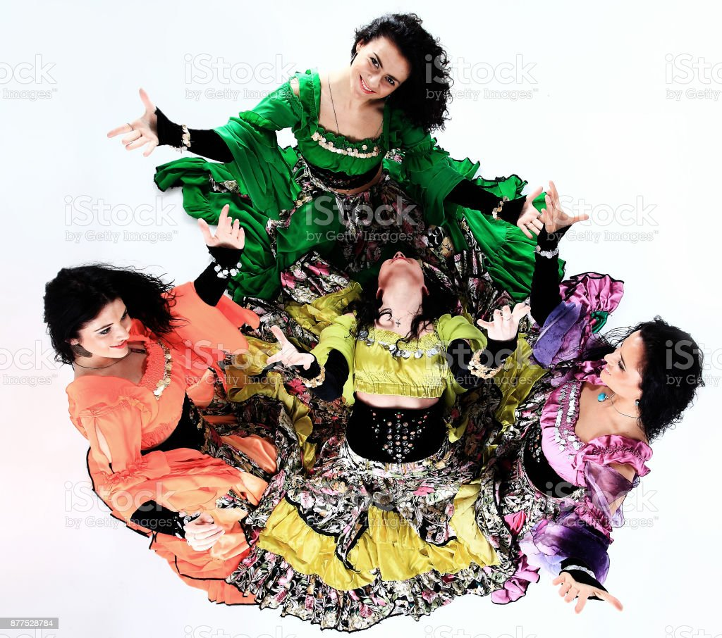 professional Gypsy dancing group in national costumes performing folk dance stock photo