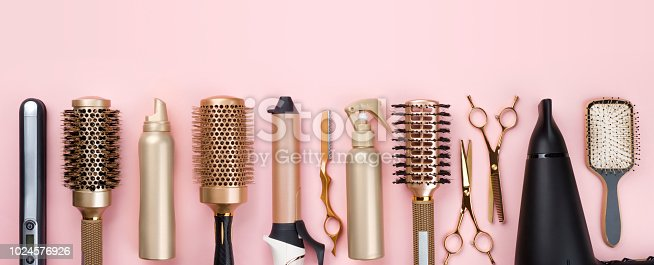 istock Professional hair dresser tools on pink background with copy space 1024576926