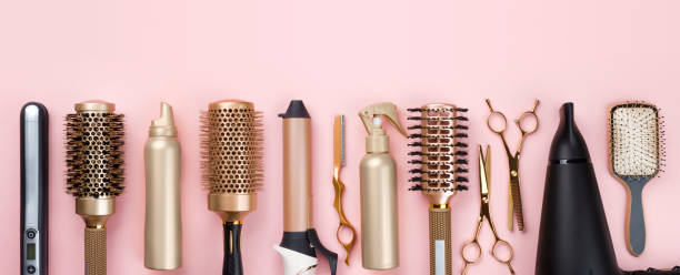 Professional hair dresser tools on pink background with copy space stock photo