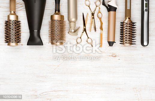 istock Professional hair dresser tools on wooden background with copy space 1020439516