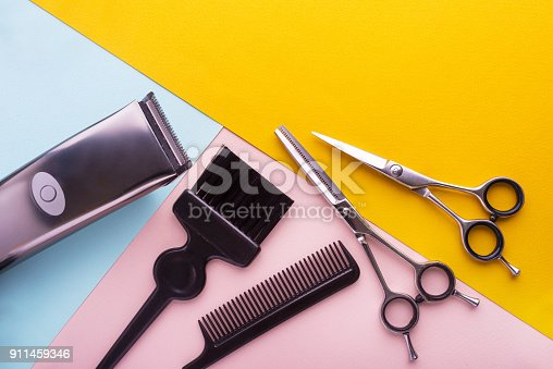 istock Professional hairdresser tools on colored background 911459346