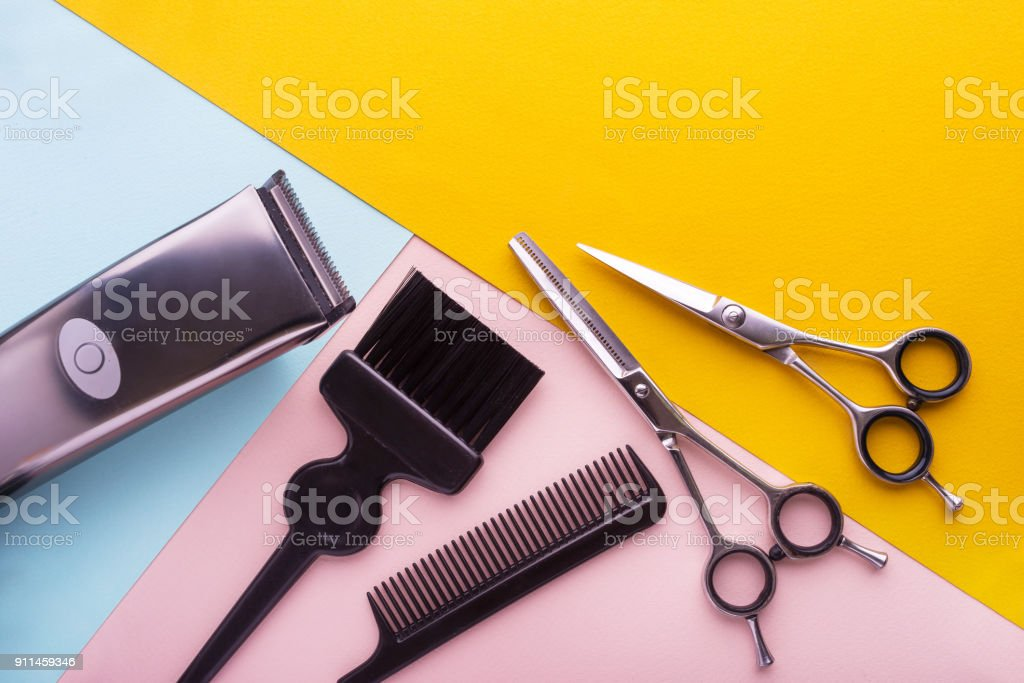 Professional hairdresser tools on colored background stock photo