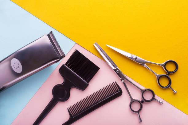 professional hairdresser tools on colored background - hairdresser стоковые фото и изображения