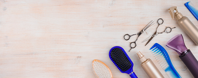 istock Professional hairdresser tools on wooden surface with copyspace at left 639310102