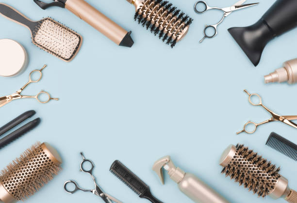 Professional hairdressing tools and accessories on blue background with space stock photo