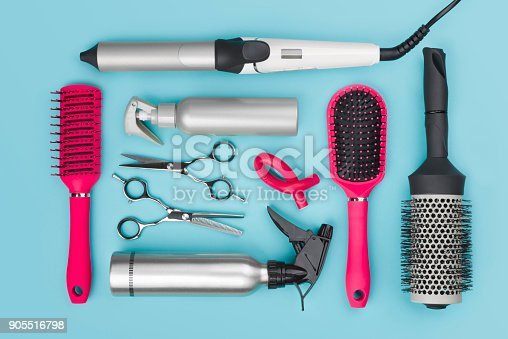 istock Professional hairdressing tools isolated on blue background, view from above 905516798