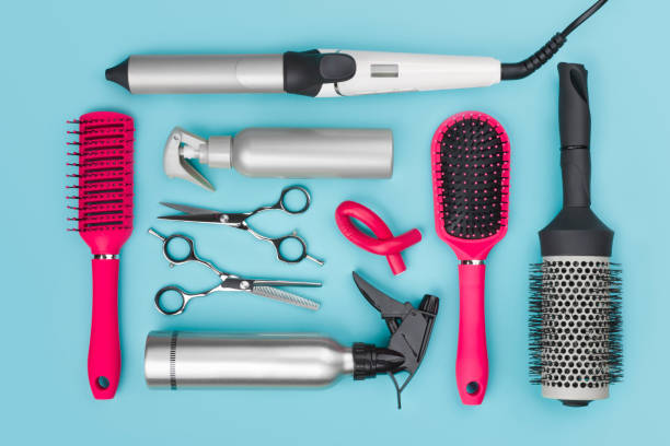 Professional hairdressing tools isolated on blue background, view from above Professional hairdressing tools isolated on blue background, view from above hairbrush stock pictures, royalty-free photos & images