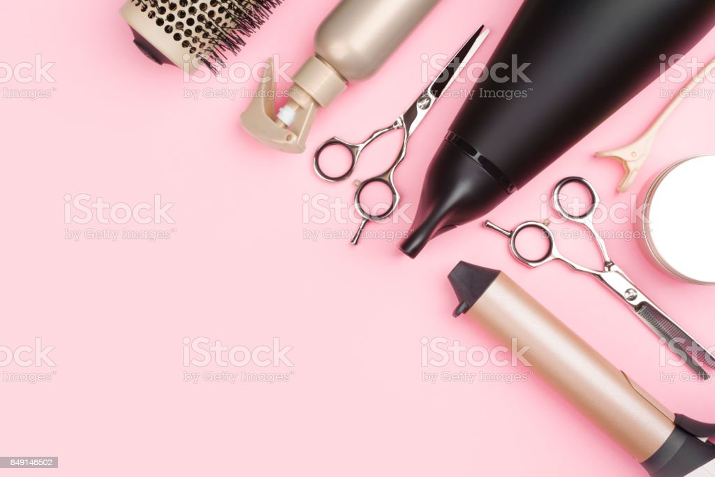 Professional hairdressing tools on pink background with copy space stock photo