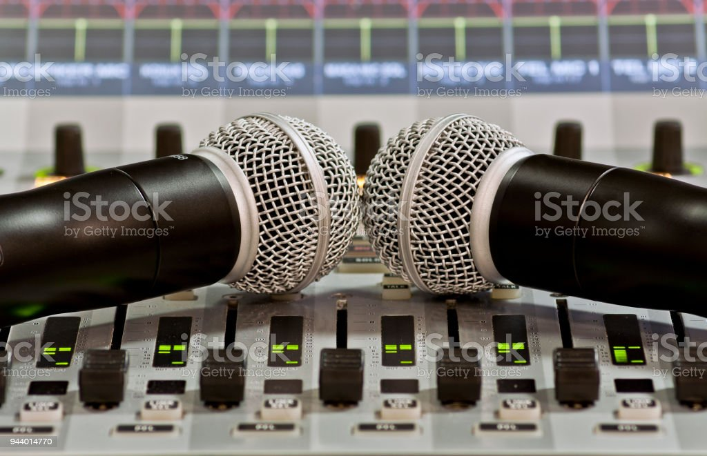 Professional Handheld Microphone on Sound Mixer stock photo