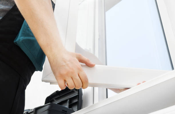 Professional handyman installing window at home. Professional handyman installing window at home. replacement stock pictures, royalty-free photos & images