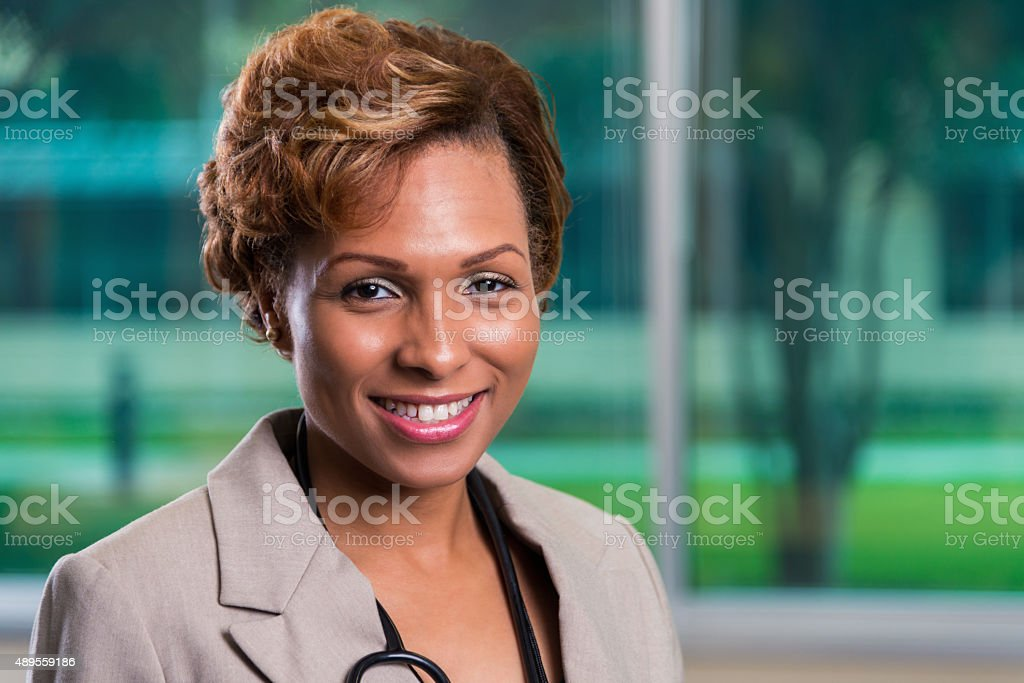 Professional headshot of African American female doctor stock photo