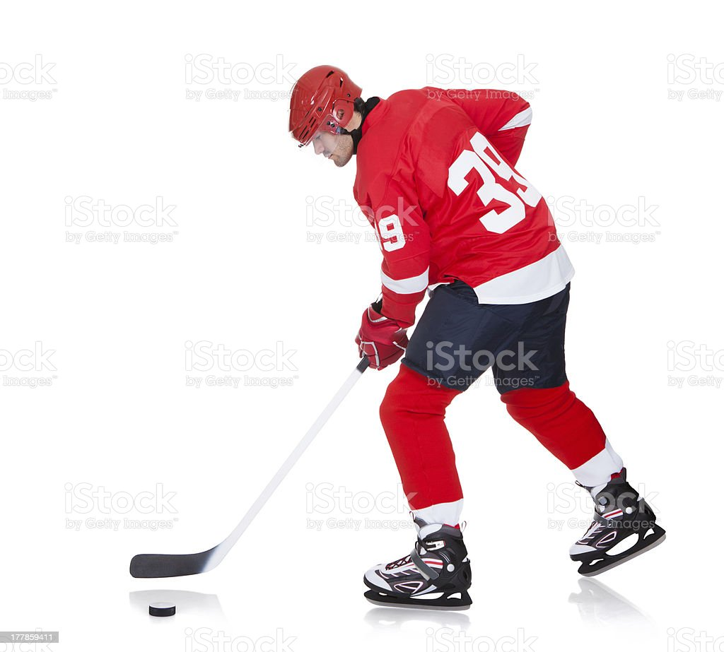 Professional hockey player skating on ice royalty-free stock photo