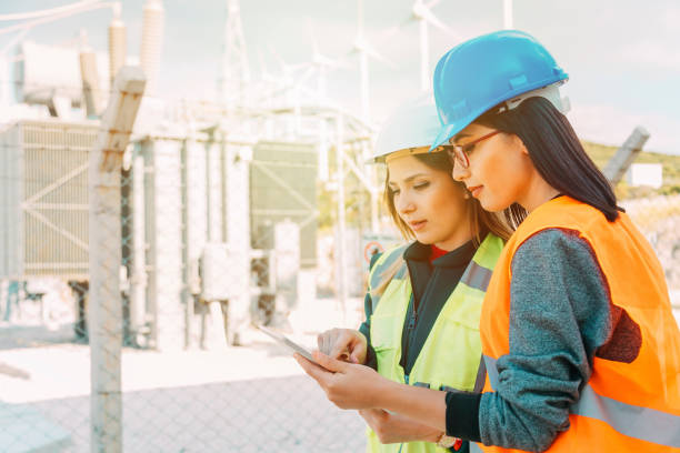 Professional industrial engineer women operating in electricity substation stock photo