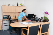 Professional Janitorial Service - Woman Cleaning an Office