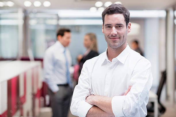 Professional looking business man posing for photo stock photo