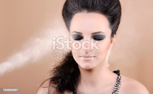 nice woman with eyes closed wearing a professional make up .