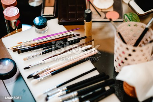 istock Professional makeup brushes and make-up eye shadows. Cosmetic for woman make up. 1189545051