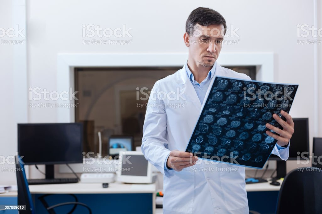 Professional male oncologist putting a diagnosis stock photo