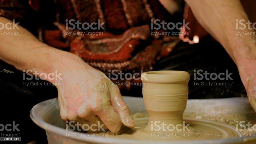 Professional male potter working in workshop stock photo