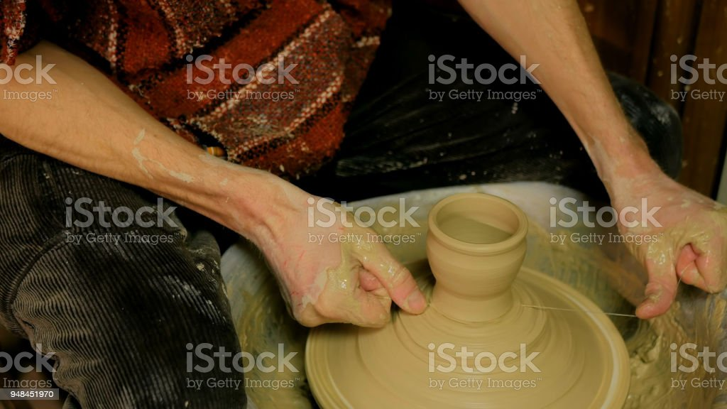 Professional male potter working in workshop, studio stock photo