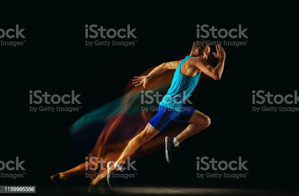 Professional male runner training isolated on black studio background picture id1159995356?b=1&k=6&m=1159995356&s=612x612&h=fwqgqzrj98o9j0nmxd7x7pf8gp4gsr9l  crwoncnly=
