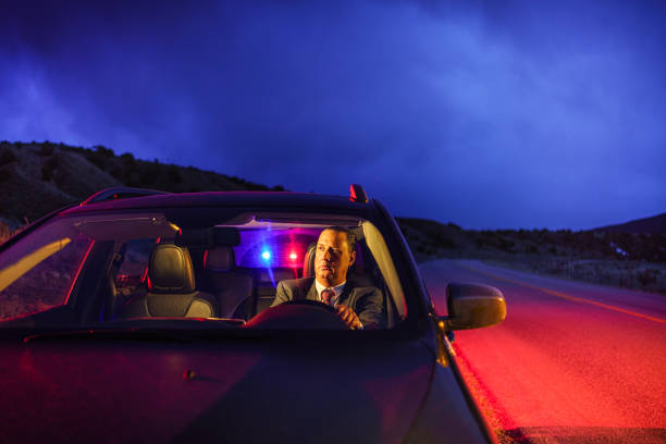 Professional Man in Suit Being Pulled Over by Police stock photo