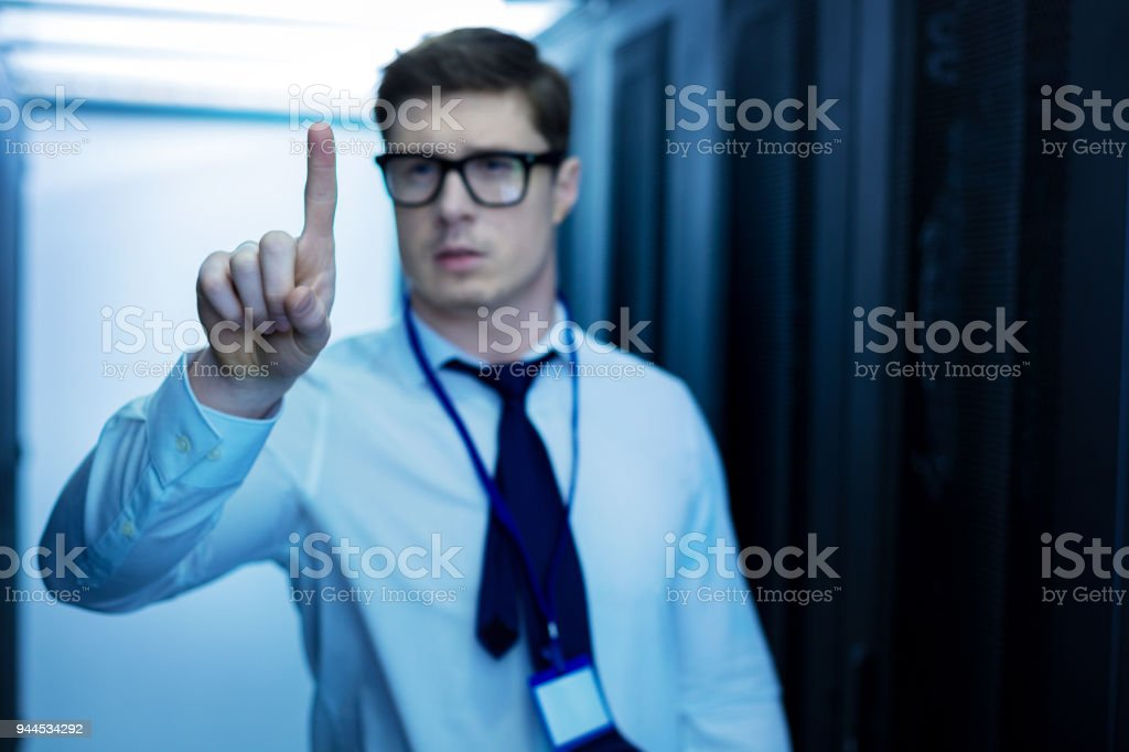 Professional man pointing his finger stock photo