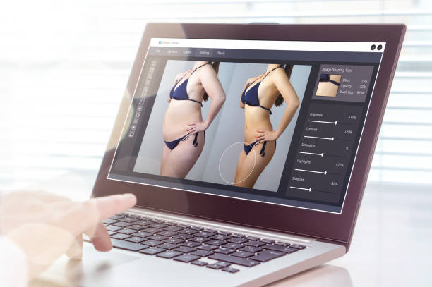 professional man using laptop to transform chubby woman slim. heavy photo editing with computer software. standard of beauty, body image and post production concept. - retouched image stock photos and pictures