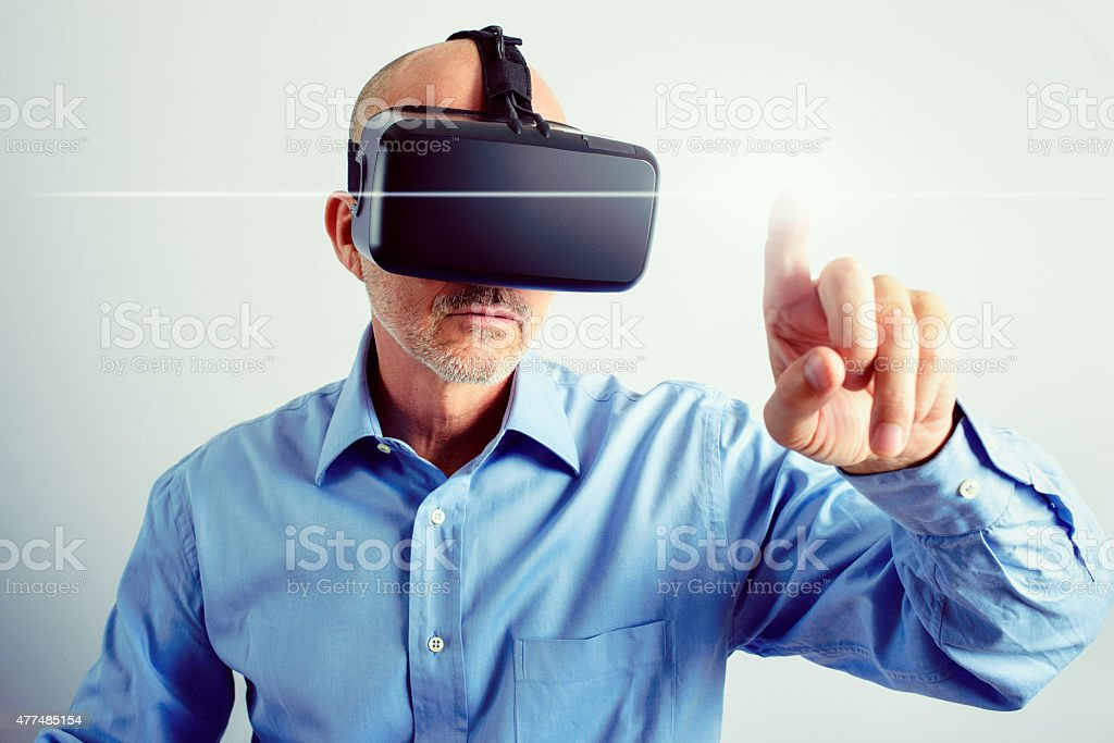 Professional Man Using Virtual Reality Headset With Gestures stock photo