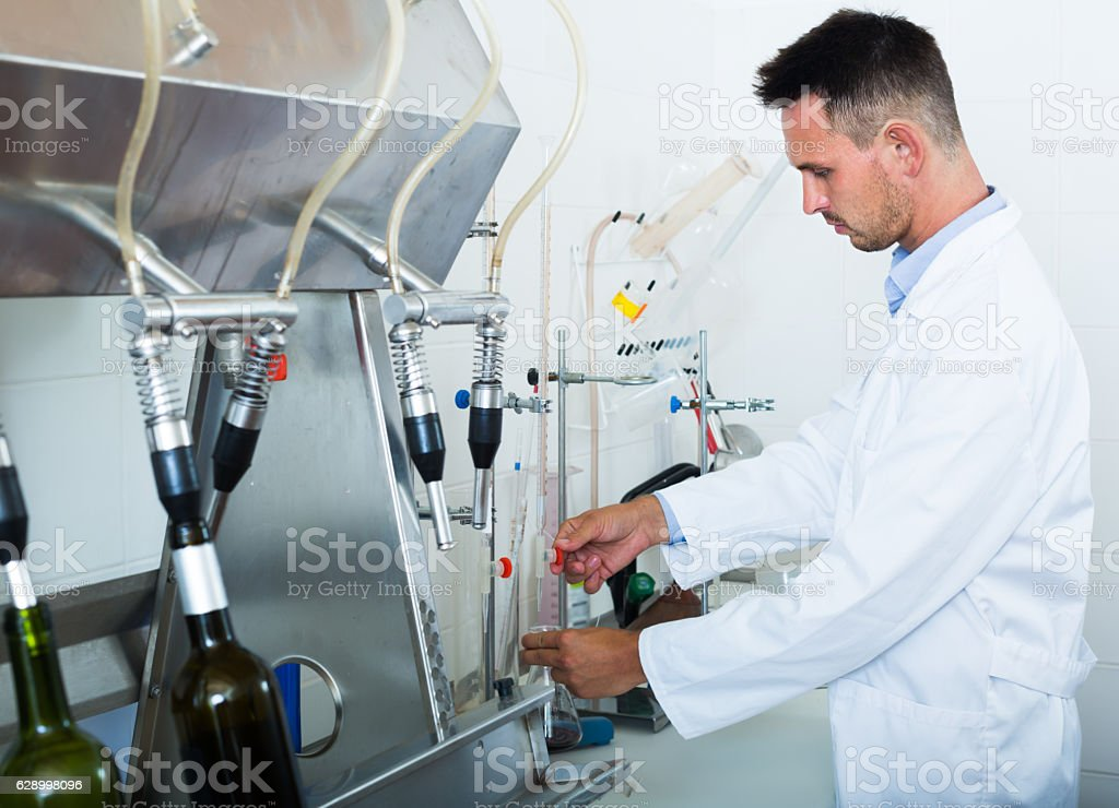 Professional man working on quality of products stock photo