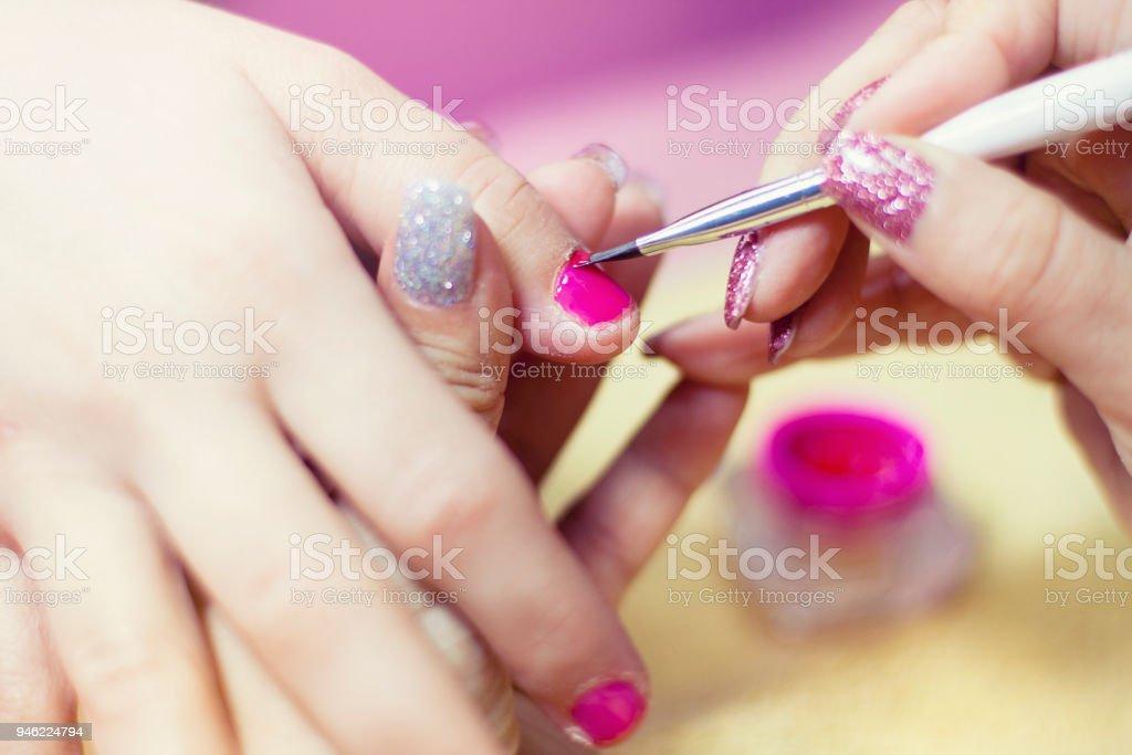 Manicure process close up.