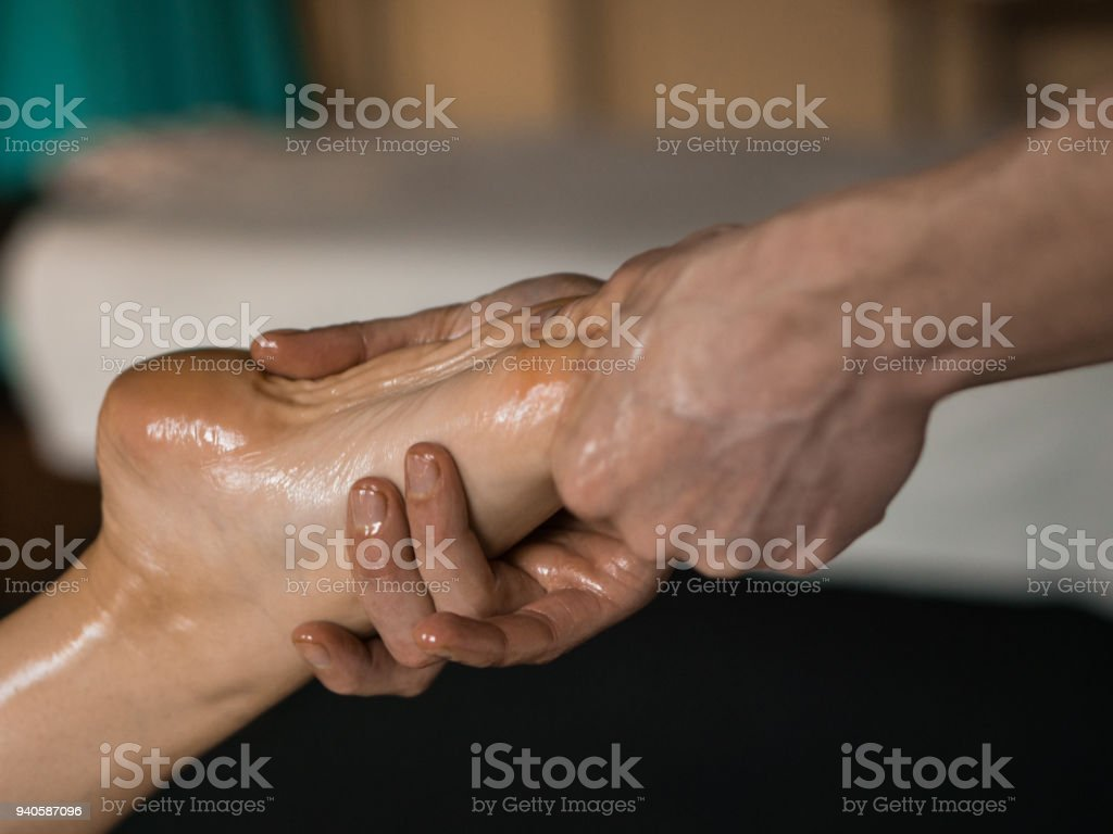 Professional Masseur Doing Deep Tissue Oiled Massage To A Girl At Ayurveda Massage Session Royalty