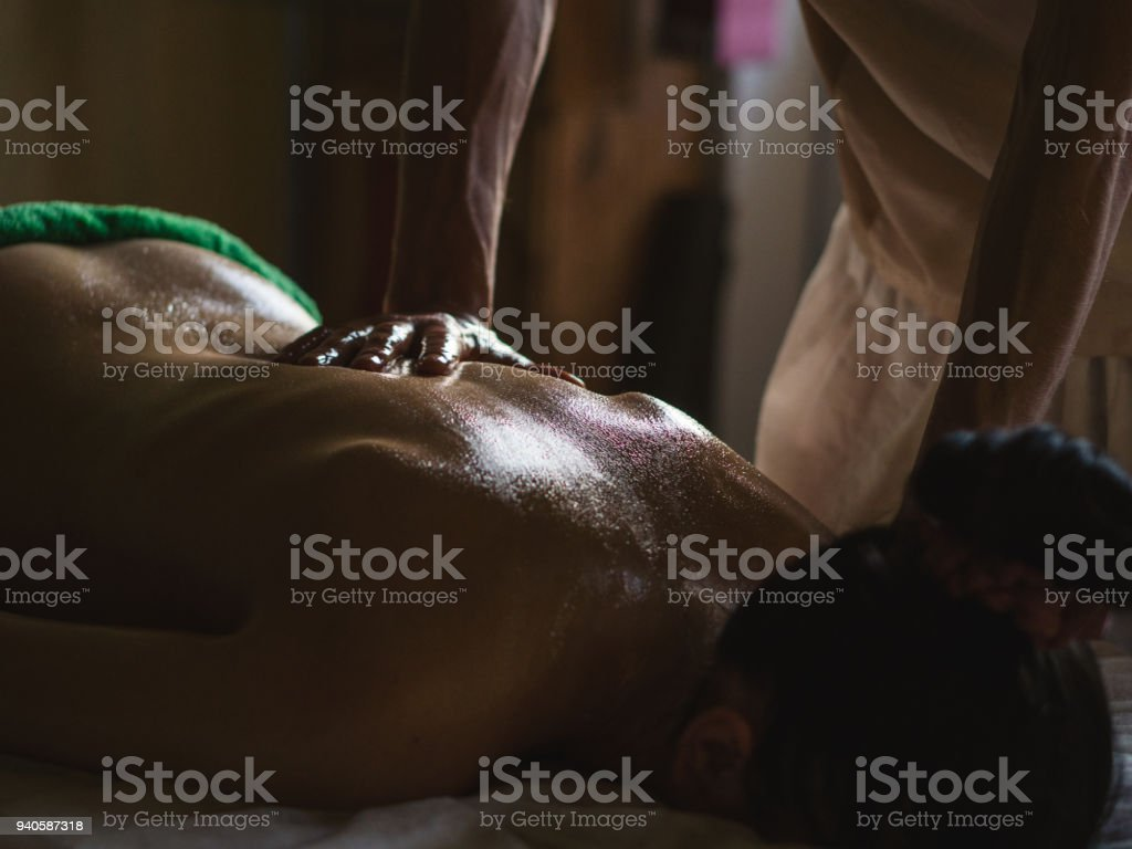 Professional Masseur Doing Deep Tissue Oiled Massage To A Girl At Ayurveda Massage Session Stock Image