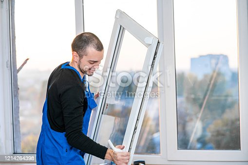 Professional master at repair and installation of windows, at work.