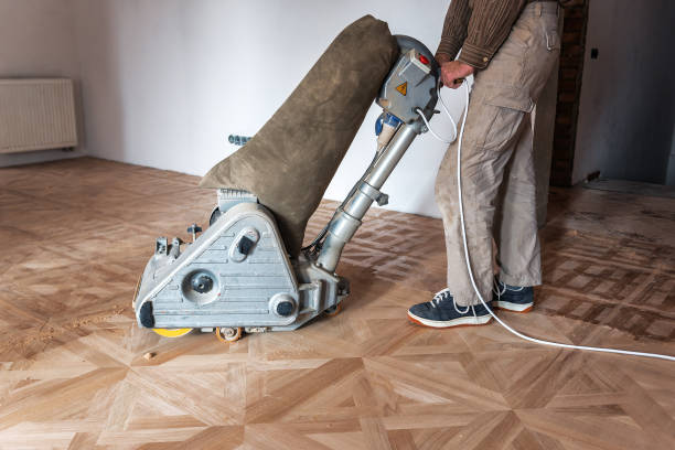 professional master grinding a parquet stock photo