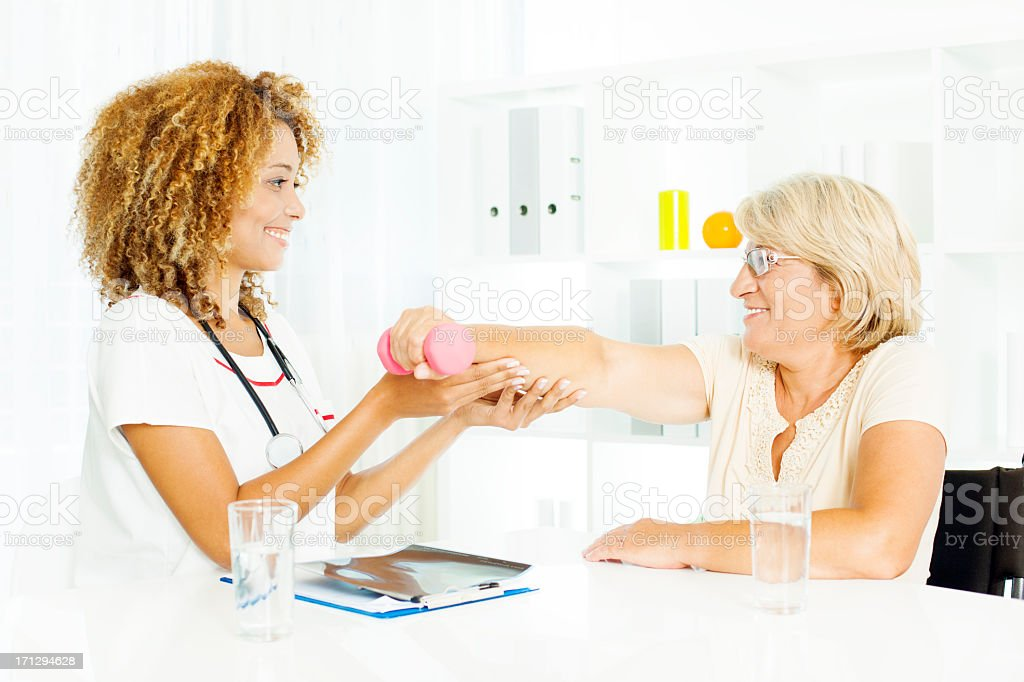 Professional medical exam and physical therapy plan. stock photo